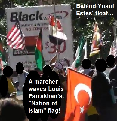A marcher in the American Muslim Day Parade waves the Nation of Islam flag right behind the GuideUS TV float with Yusuf Estes.